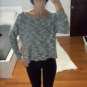 Sweater with open shoulder